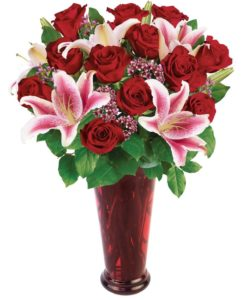 bouquet includes twelve premium long stemmed Ecuadorian red roses, along with two stems of stargazer lilies, accented with wax flower in a ruby red vase